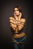 brunette girl woman bound with rope prisoner gray background emo