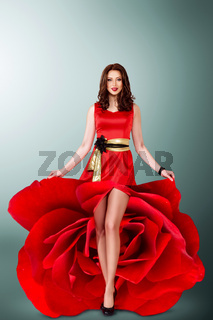 Beautiful young girl in red flower dress