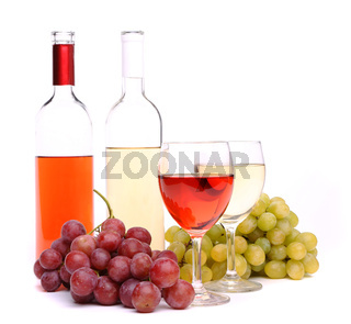 Glasses, bottles of wine and grapes