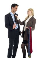 Man and woman choose a tie from