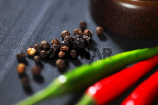 Wooden peppermill with pepper