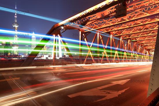 light trails on the old bridge in shanghai
