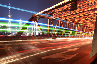 light trails on the old bridge in shanghai