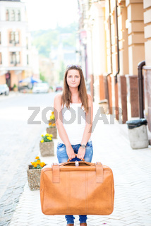 Sad looking girl with suitcase
