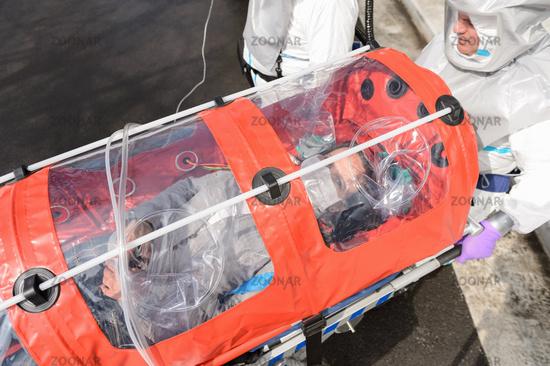 Biohazard team with virus patient in stretcher