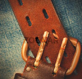 unfastened old leather belt with vintage buckles