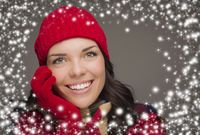 Smilng Woman Wearing Winter Hat and Gloves with Snow Effect