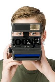 Junge hinter der Kamera