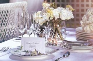 Invitation card on outdoor wedding table