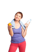 attractive woman 50 years with an orange and a bottle of water