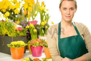 Florist with spring potted flowers
