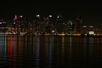 The skyline of San Diego at night with reflection in the water.