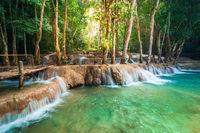 Jangle landscape with Kuang Si waterfall. Laos
