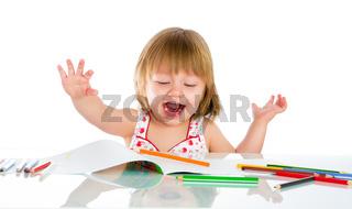 Little baby girl draws pencil