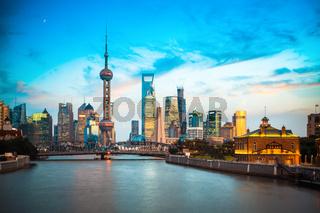 dusk scene of shanghai skyline and suzhou river