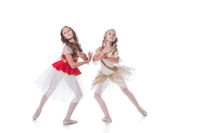 Shot of graceful young ballerinas posing at camera