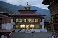 Illuminated tower building atTrashi Chhoe Dzong