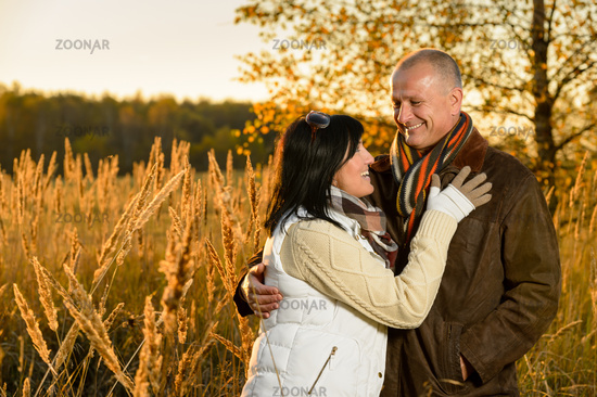 Couple in love hugging in autumn sunset