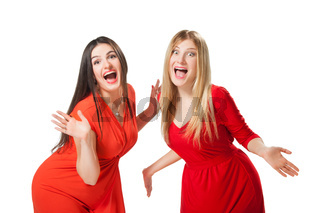Shocked two women holding hands to open mouth