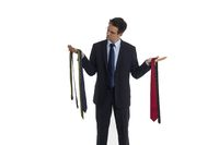 Man selects a tie