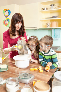 Young family baking in the kitchen