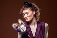 Actress posing with mask. Concept of Two-Face.