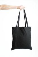 Hand Holding Black Empty Bag