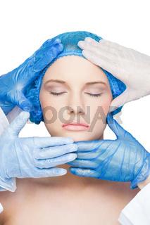 Surgeons examining content blonde