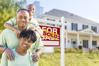 African American Family In Front of Sold Sign and House