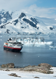 tourist ship that stands in the strait near the penguin colony