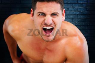 Composite image of bodybuilder shouting