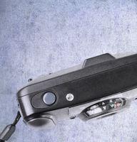 An old used film plastic camera over grunge backgr
