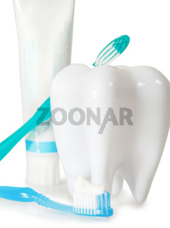 Tooth brushes with mint, tooth paste and dental floss isolated on white