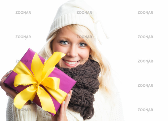 blonde woman holding a present