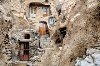Facade of houses excavated in rock cones in Kandovan village in Iran
