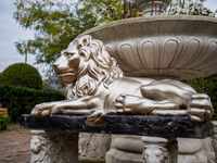 Large silver lion statue on bench