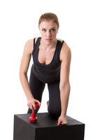 Confident female athlete posing looking at camera