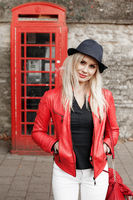 Attractive trendy young woman in a red jacket