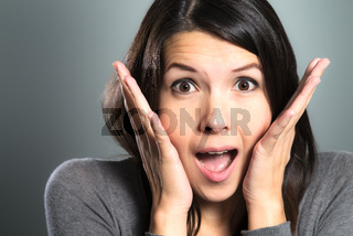 Attractive woman screaming in terror