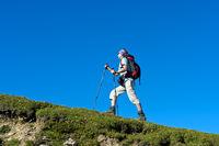 Ascending hiker, Alps
