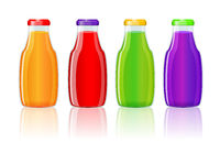 Juice bottles over white background