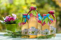 Bottles with pine and lemon syrup
