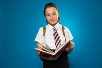 Schoolgirl with a lovely smile holding a book