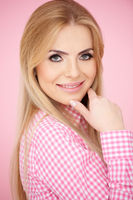Smiling Blond Woman in Pink Checkered Shirt