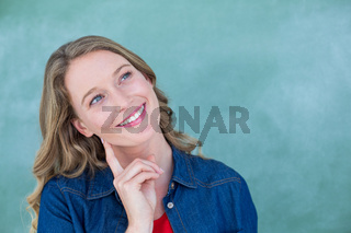 Smiling teacher standing in front of blackboard