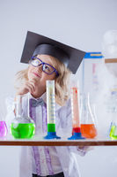 Image of thoughtful little girl in chemistry lab