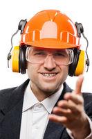 Businessman in safety hardhat helmet gesturing han