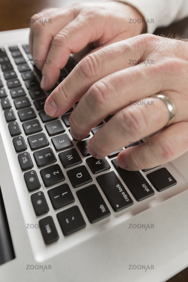 Male Hands Typing on Laptop Computer