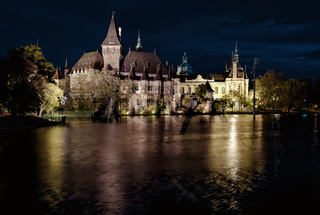 Night view of Vajdahunyad castle from lakeside. Budapest, Hungary