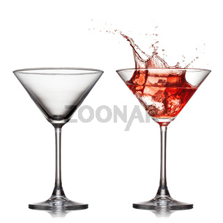 empty and full martini glass with red cocktail with splash isolated on white